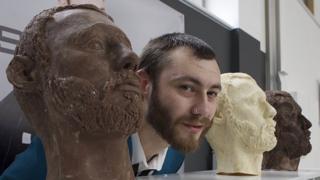 Dean Morris next to his chocolate heads