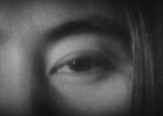 Yoko Ono, Eyeblink, 1966, performed by YokoOno, Filmstill.