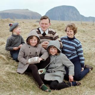 A man and woman wearing Fair Isle jumpers pose with three children on one of the Shetland Islands in 1970.