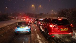 Cars stuck in traffic on Ringway West in Basingstoke due to snowfall in the area on Friday 1 February