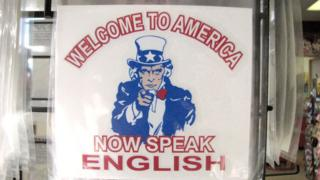 "Poster that says: ""Welcome to the USA, now speak English"""