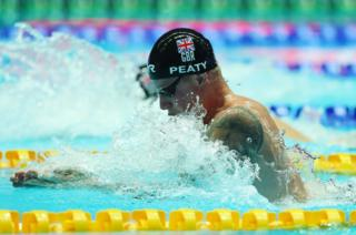 Adam Peaty of Great Britain competes in the Men's 100m Breaststroke Final
