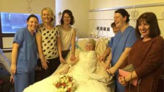 Hayley Clarke on her wedding day with the nursing team