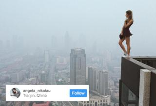Angela Nikolau standing on the edge of a building in China