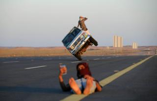 "Saudi men perform a stunt known as ""sidewall skiing"""
