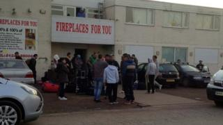 Migrant workers outside the premises at Deeside Lane