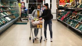 Tesco shoppers wearing face masks