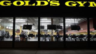 People work out at a Gold's Gym in Washington, DC.