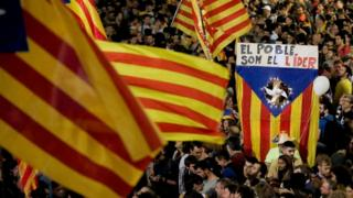Catalans wave flags as they celebrate parliament declaring independence