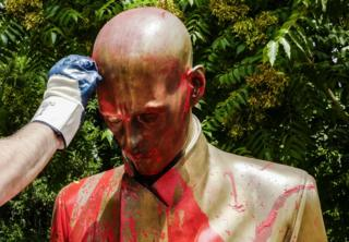 "Volunteers of the association Retake clean a statue of famous Italian journalist Indro Montanelli, which stands in a garden of the same name, that was sprayed painted red and tagged with the words racist and rapist, in Milan, Italy, 14 June 2020. An anti-fascist group had called on Milan""s mayor to remove the statue because Montanelli bought and married a young Eritrean girl after volunteering for Fascist leader Benito Mussolini""s colonial invasion of Ethiopia in 1935."