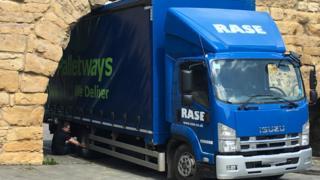 Lorry under arch