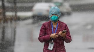 A government worker in Wuhan at the epicentre of the coronavirus outbreak in China, 16 February 2020