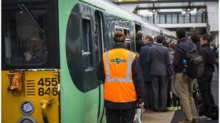 passengers getting on to crowded Southern rail train