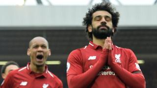 Liverpool goalscorer Mohamed Salah (right)
