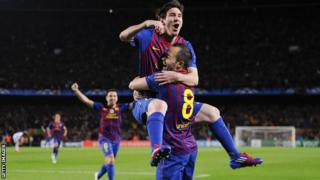 Lionel Messi celebrates with Barcelona team-mate Andres Iniesta