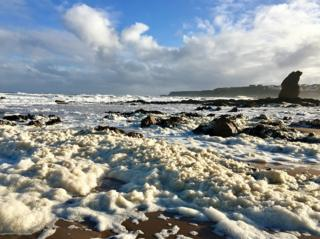 Storm conditions produce algal foam on Cullen beach, Moray