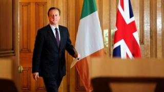 David Cameron arrives at the joint press conference
