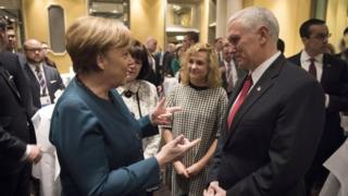 Angela Merkel and Mike Pence talking informally at the Munich Security Conference, 18 February 2017