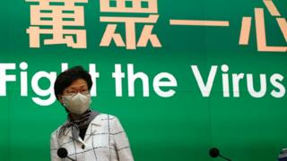 Carrie Lam wearing a face mask at a ress conference