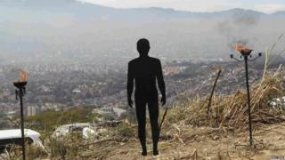"A figure symbolizing missing people is pictured during a ceremony at ""La Escombrera"" rubbish dump in Medellin."