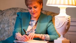 Nicola Sturgeon signing letter