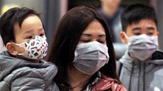 People wearing face masks at a metro station in Taipei, Taiwan