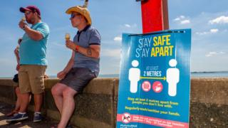Visitors eat ice creams at Southend, Essex, on 20 May 2020