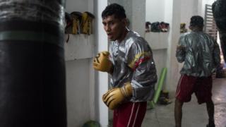 Nicaraguan boxer Ramiro Blanco trains with a punchbag