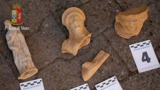 A police photo of some of the terracotta figures seized
