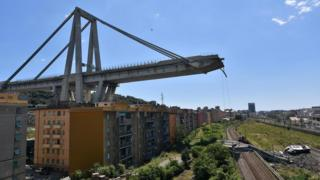 A view of the collapsed Morandi bridge the day after the disaster in Genoa, Italy, 15 August 2018.
