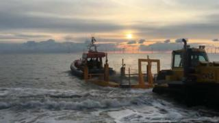 Lifeboat goes out to sea.