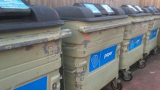 shared paper recycling bins.