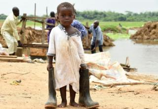 A Nigerian boy carries his father's boots in Ogun State, south-west Nigeria - Wednesday 5 October 2016