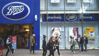Customers outside Boots store