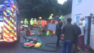 Fire engine overturns