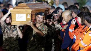 Italian soldiers carry a coffin at a funeral service for victims of the earthquake in Amatrice, central Italy, August 30, 2016