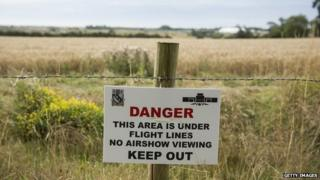 A danger sign in fields near Shoreham, England