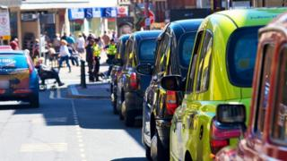 Taxis lined up in a rank in Blackpool.