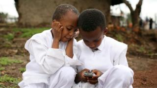 kids playing with a phone