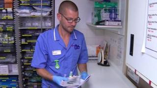 Will Pooley working as a nurse