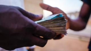 Man taking money