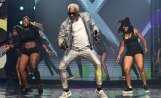 Rugby Congolese musician Awilo Longomba on stage with dancers at the Afrima ceremony in Lagos, Nigeria - Sunday 24 November 2019