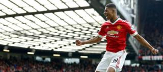 Marcus Rashford, celebrates after he sores the opening goal of the game during the English Premier League soccer match between Manchester United and Arsenal at Old Trafford Stadium, Manchester, England, Sunday, Feb. 28, 2016.