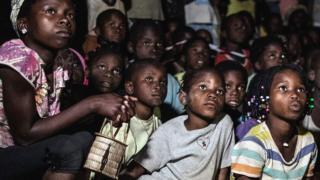Children watching cartoon in Mozambique