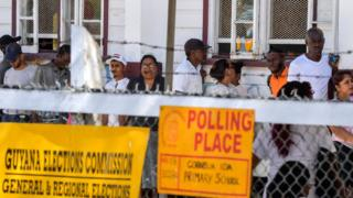 Guyanese citizens line up to vote, in Leonora, Guyana on 2 March