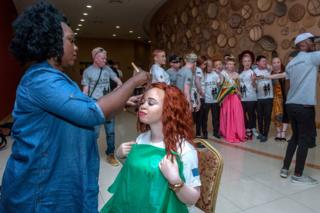 A make-up lady prepares a contestant backstage prior to the first Mister and Miss Albinism Beauty Pageant and Talent Show at the Bingu Conference Centre on September 7, 2019 in Lilongwe