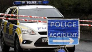 Police car and accident sign