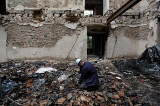 Archeologist Pedro Luiz von Seehausen searches through the rubble for Egyptian steles at the National Museum in Rio de Janeiro