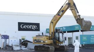 A large digger in the carpark of Asda in Antrim
