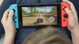 A boy plays the Nintendo Switch